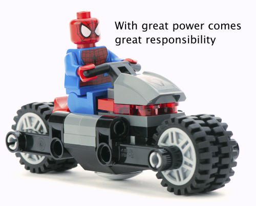 """Lego Spiderman on a bike with quote: """"With great power comes great responsibility"""""""