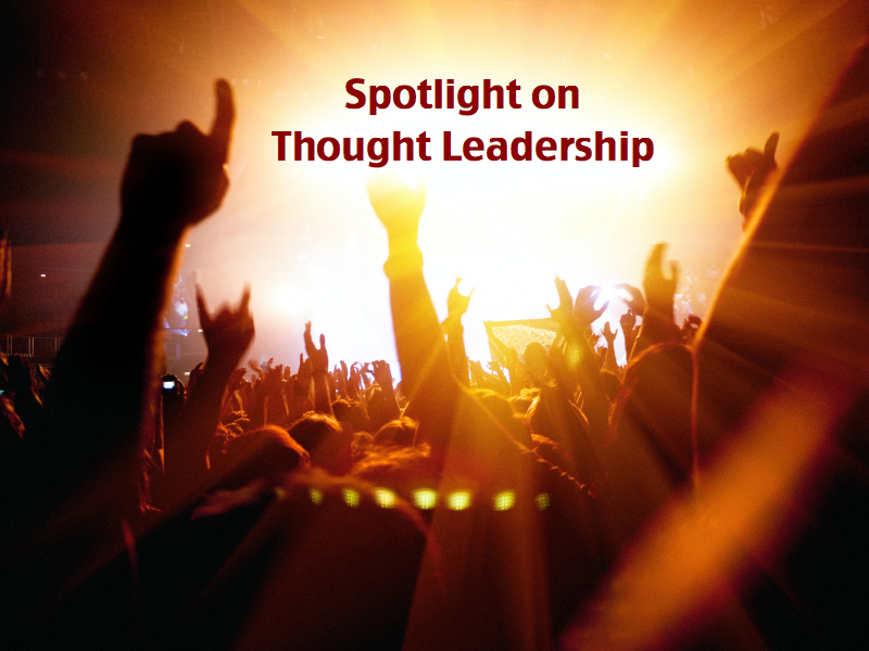 "Rock concert crowd facing a spotlight with the text ""Spotlight on Thought Leadership"""