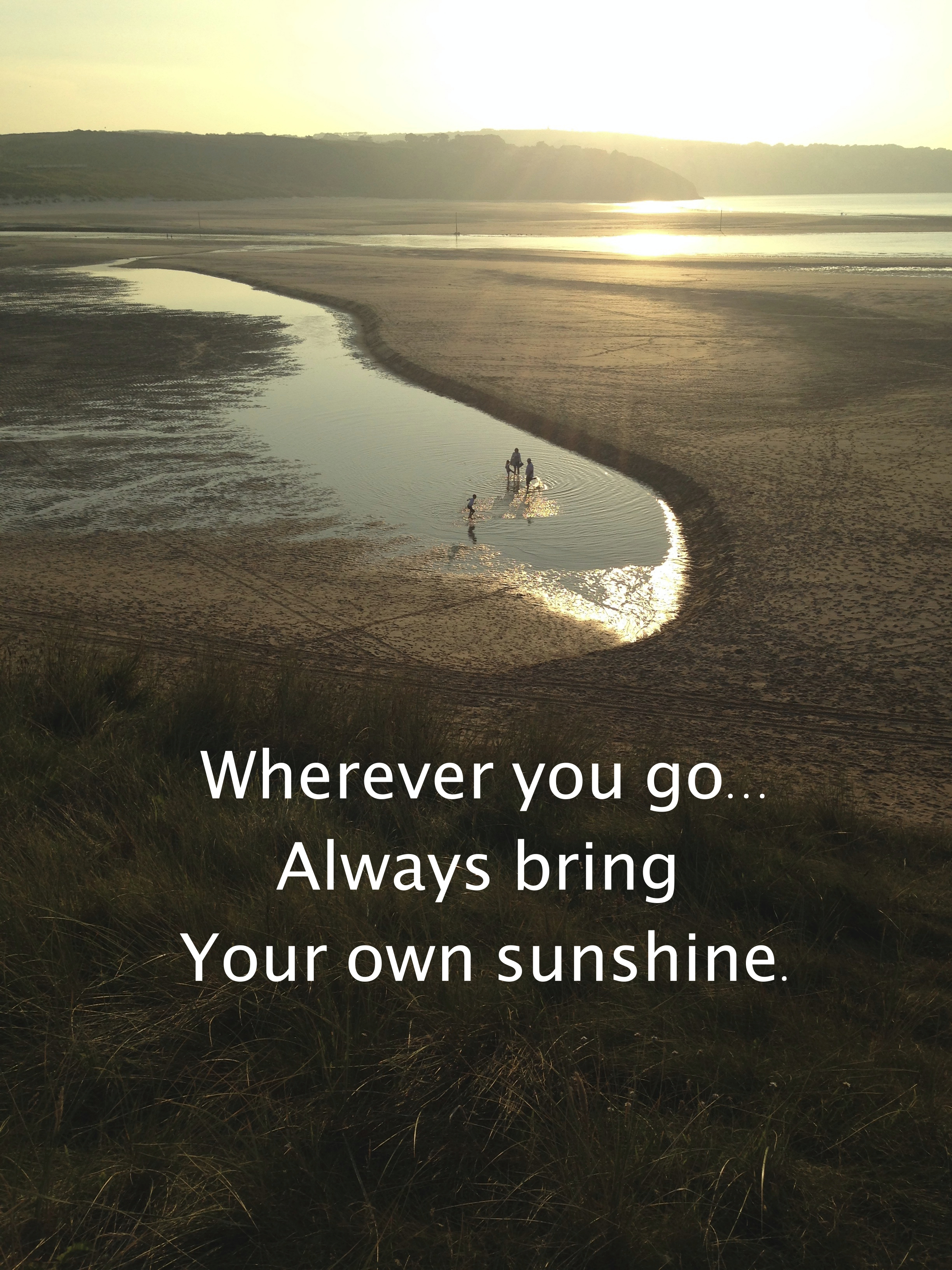 Quote against backdrop of beach bathed in sunshine: Wherever you go always bring your own sunshine