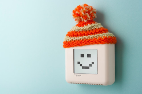Digital thermostat with smile and woolly hat