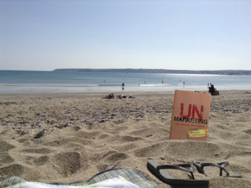 UnMarketing book on a beach