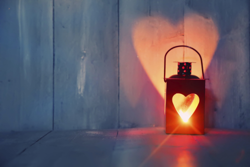 Valentine's lantern with heart illuminated on wall