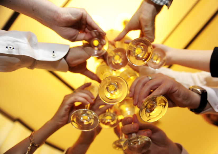 raising wine glasses to toast goodwill to all men